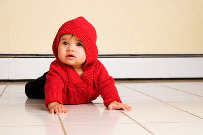 Toddler crawling on tile floor